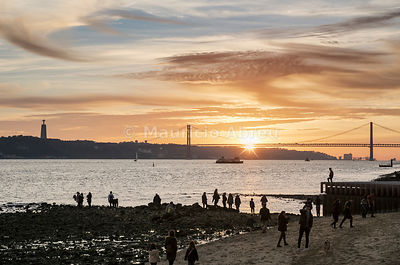 Sunday afternoon by the Tagus river, at sunset. Lisbon, Portugal