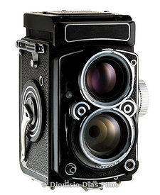 Old mono reflex camera isolated on white background