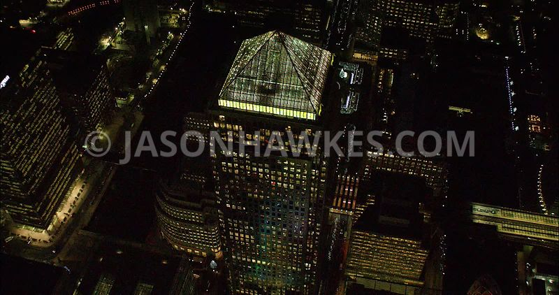 London night aerial footage, of Canary Wharf close up at night.