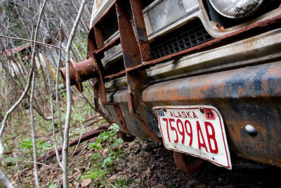 License plate from 1977 on an abandoned truck, Cape Yakitaga, Alaska
