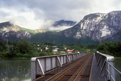 Railroad tracks in Squamish, British Columbia, with the Squamish Chief in the background. The Chief is the second largest granite monolith in the world.