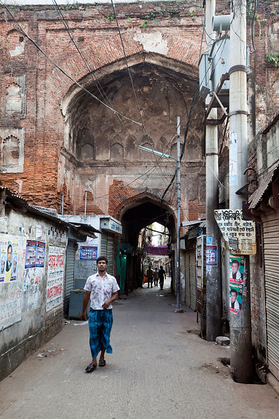 Bangladesh - Dhaka - A man walks beneath the Bara Katra, built in 1644, it is the oldest building in Dhaka