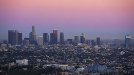Wide Shot: Sun Sets Quickly Over A Spread Of Neighborhoods In Front Of L.A. Skyline