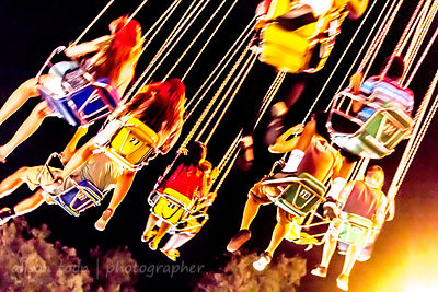 Riding the WaveSwinger at night