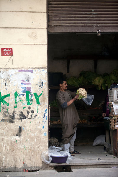 Egypt - Cairo - A man bags a cauliflower in a shop in Islamic Cairo