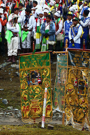 Dance groups and banners on hillside during Qoyllur Riti festival, Peru