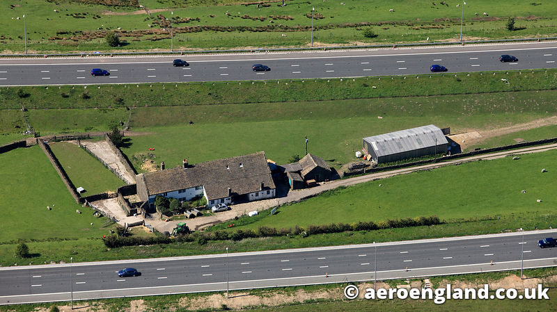 aerial photograph of the farm in the middle of the M62 Motorway in Yorkshire England UK