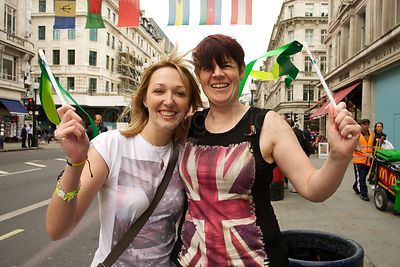 Excited Girls Waving Flags for the Paralympic Torch Run in 2012