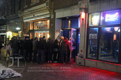 A crowd lines up for entry to The Library Nightclub, 113 E. College St in Iowa City late Saturday night. Copyright Justin Torner 2012 http://justintorner.photoshelter.com