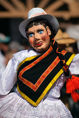 A dancer wears a mask during Cusco Week festivities, Cusco, Peru