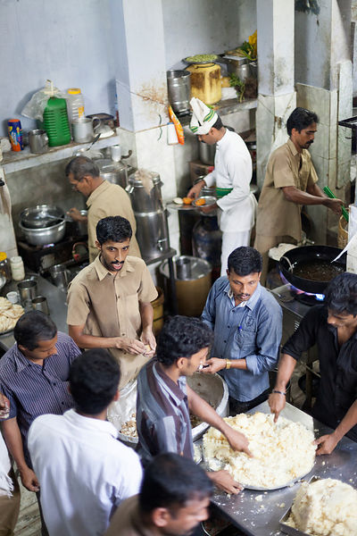India - Thelassery - Kitchen staff prepare lunch at the Indian Coffee House