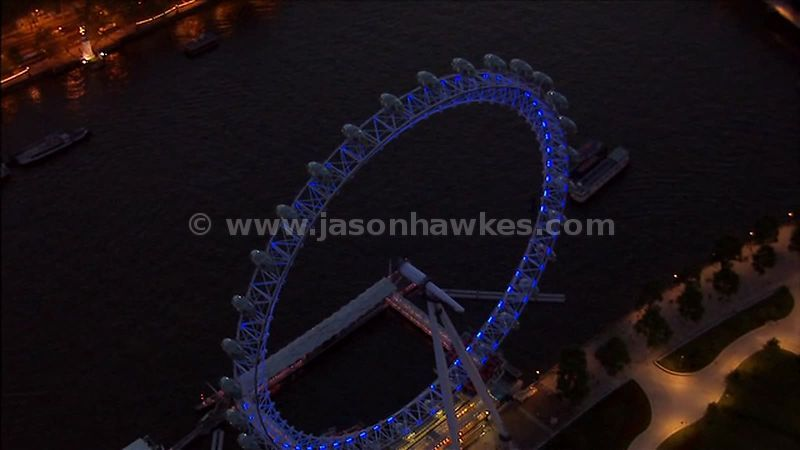 Aerial footage over the London Eye at night, London, England, UK