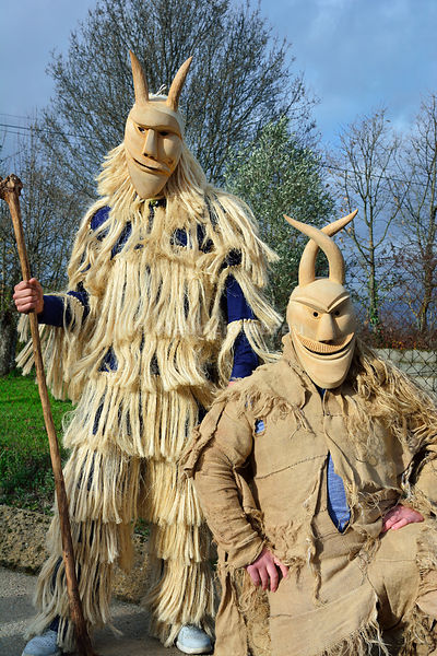 Caretos with wooden masks from Lazarim, used during the Carnival. Beira Alta, Portugal