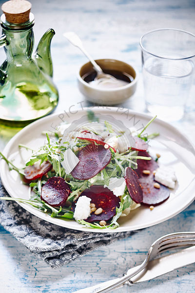 Roasted beet salad with arugula, pine nuts and goat cheese