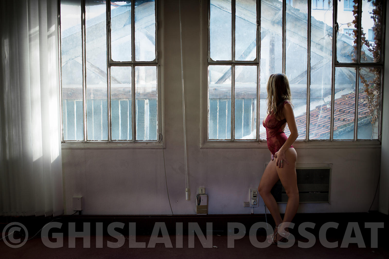 Sexy pictures - glamour woman underwear watching a window urbex