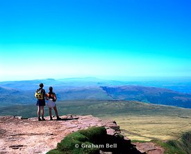 couple on summit of corn du brecon beacons national park wales