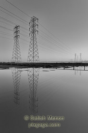 Power lines and reflection in water