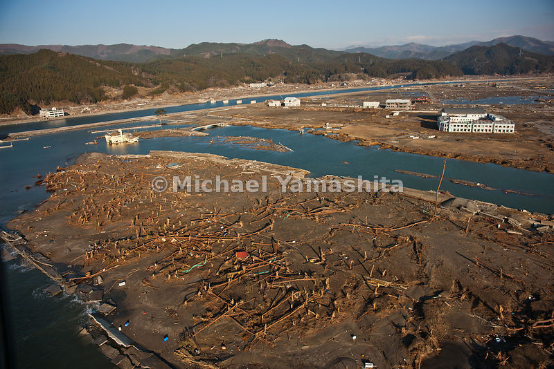 March 11 Great Eastern Japan Earthquake and Tsunami. Measuring 9, biggest ever to hit Japan destroying the NE coast line cities and villages for 200 plus miles. Aerials over Rikuzentakata showing total destruction.  The wreckage was furthest along getting cleared having made the most progress.  Also shot panos from ground.  Also major resort on the short of Rikuchu Kaigan Natiional Park which extends all along the coast where the Tsunami hit.