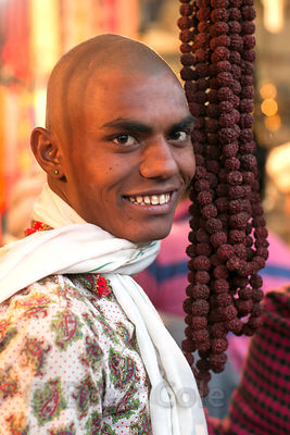 A man with tonsure or shaved head for religious devotion during pilgrimage to Pushkar, Rajasthan, India