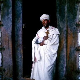 A Ethiopian priest at the cave monestery of Yimrehane Kristos near Lalibela, Ethiopia