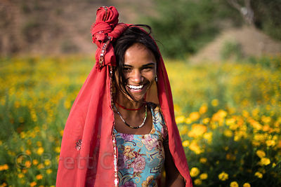Happy women working in the beautiful flower fields that surround Amba village, Rajasthan, India