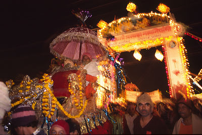 India - Allahbad - A leader of an Akhara, a Saddhu regiment is paraded to the ganges on a palanquin held shoulder high at the Ardh Kumbh Mela 1995, Allahbad, India