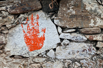 Painted palm print on a temple in Pushkar, Rajasthan, India