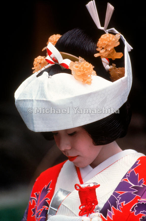 Three Ages of the Japanese Woman - a girl from Matsushima, a bride wearing the elaborate kimono and headpiece for the Shinto ceremony, and an old woman from Nikko.