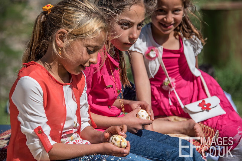 Yezidi Minority Group Children Opening Coloured Eggs In Celebration of Sere Sal Or Yezidi New Year, In Lalish, Iraqi Kurdistan. 19th April 2017