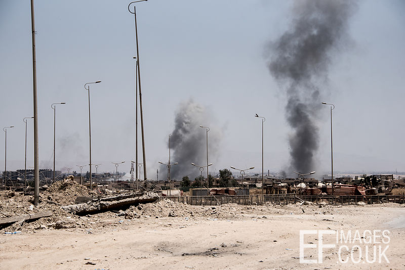 Smoke rising from explosions on the frontline in West Mosul. Iraq, 5th June 2017
