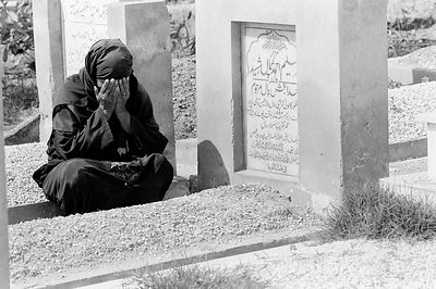 Woman weeps at the grave of her murdered child
