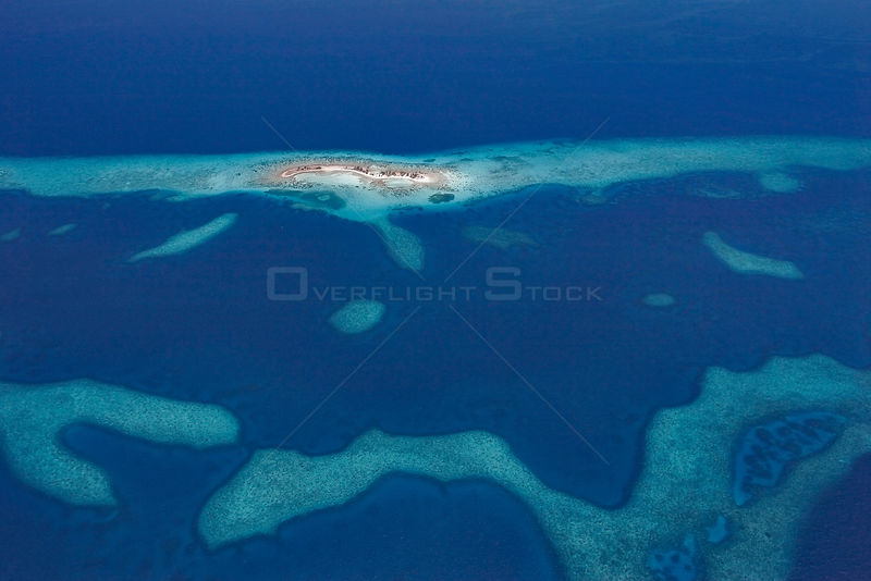 Aerial view of Laughing Bird Caye, a narrow sand caye (small island), in Laughing Bird Caye National Park. Belize Barrier Reef Reserve System UNESCO Natural World Heritage Site. Central America. Caribbean Sea.