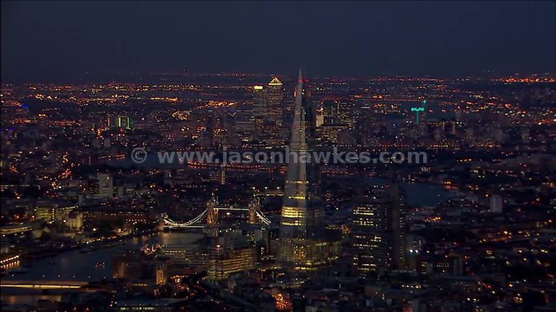 Aerial footage around The Shard and Tower Bridge at night, London England, UK