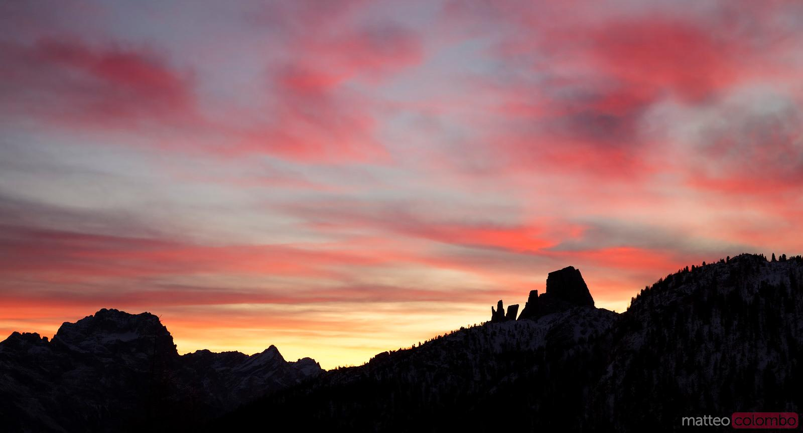 Colorful sunrise over mountain range Dolomites Italy