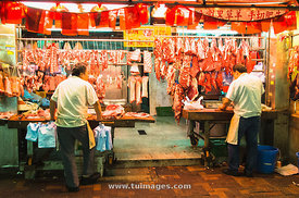 Butchers at night market of Hong Kong