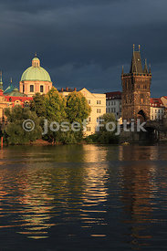 Monastery of the Knights of the Cross with a Red Star, Dome of the Church of Saint Francis Seraph and Old Town Bridge Tower, Prague, Czech Republic