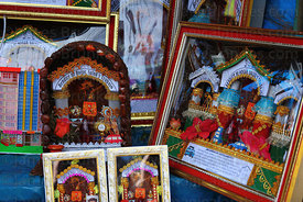 Framed pictures of Señor de Qoyllur Riti on sale during Qoyllur Riti festival, Peru