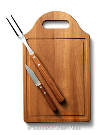 cutting board  with fork and knife