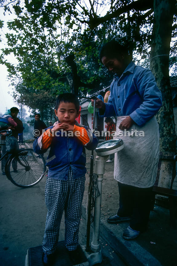 A young boy has his height and weight measured in Yangzhou, China.