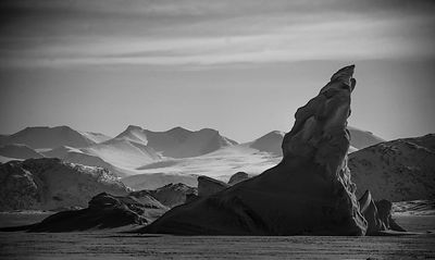 Snowy mountains, iceberg on the ice floes, Baffin Island Canada 2016 © Laurent Baheux