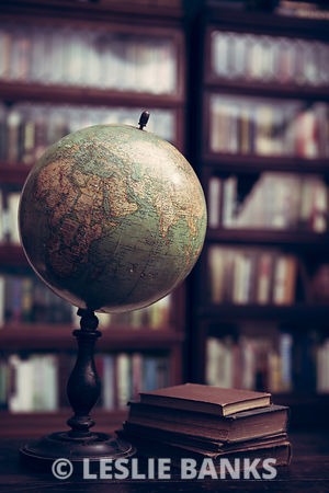 Antique globe and books