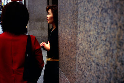 A fashionable woman outside a shop in the Ginza district of Tokyo, Japan