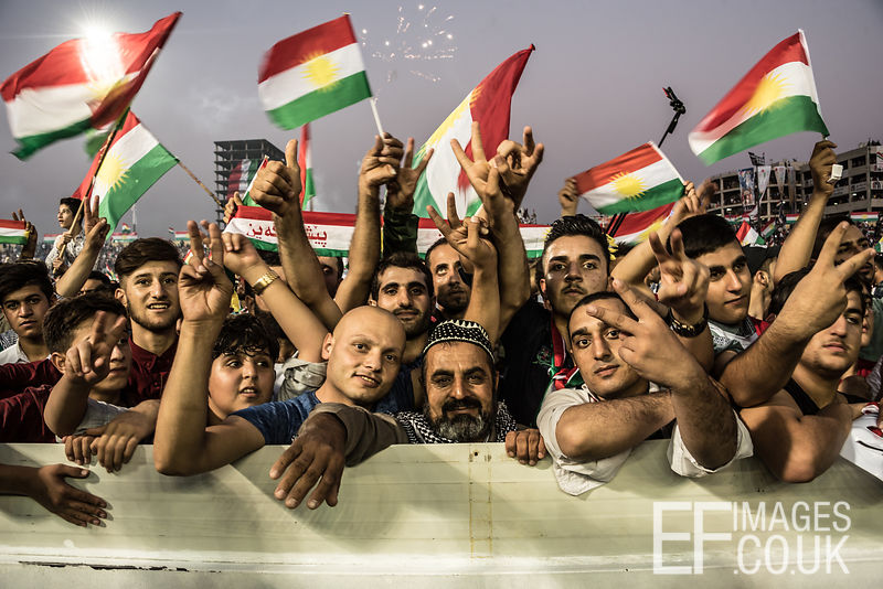 Attendees at the final pro Kurdish Independence Referendum rally, held at the Franso Hariri Stadium in Erbil, wave flags and raise banners in support of an Independent State. 22nd September 2017. Elizabeth Fitt