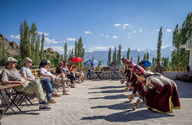 In this photograph Ladakhi folk dancers perform for an audience.