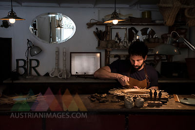 Craftsman manufacturing a mirror in his workshop