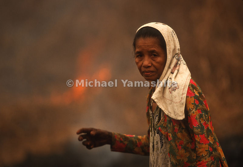 A woman shows her true emotion after Indonesia's Plague of Fire.