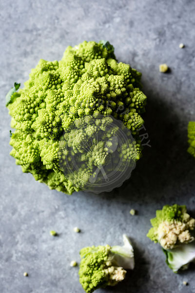 Close up of Romanesco broccoli on a wooden table