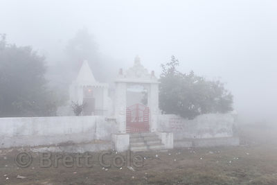 Heavy winter morning fog at the Aloo Baba temple, Ajaypal, Rajasthan, India. Aloo (potato) Baba (holy man) is an old man living at the temple who survives on nothing but potatos, and lots of hashish