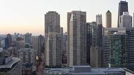 Medium Shot: Twinkling High-Rise Homes Highlight A Chicago Sunset