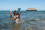 people returning from the 17th century fort on Sao Laurenco island, Ilha do Mocambique, Mozambique